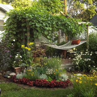 Inspiration for a small shabby-chic style full sun backyard landscaping in Other with decking for summer.