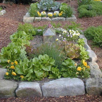 """Detail of """" one man boulder """" edging for raised beds"""
