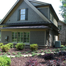 Traditional Landscape by Paragon Construction Services