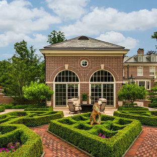 Design ideas for a traditional full sun backyard brick landscaping in Philadelphia for summer.