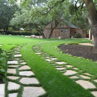 This is an example of a farmhouse back driveway garden in San Francisco with natural stone paving.
