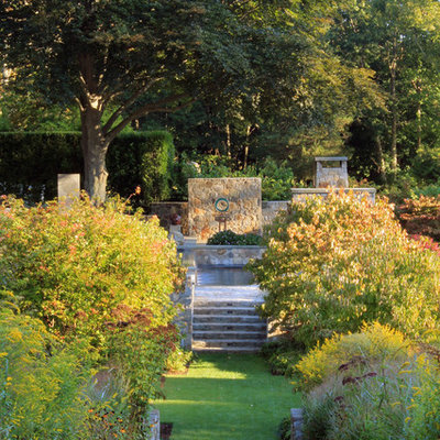 This is an example of a traditional backyard landscaping in New York.