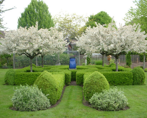 Inspiration For A Mid Sized Traditional Backyard Formal Garden In Portland.