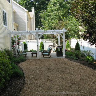 This is an example of a traditional shade backyard landscaping in Bridgeport for summer.