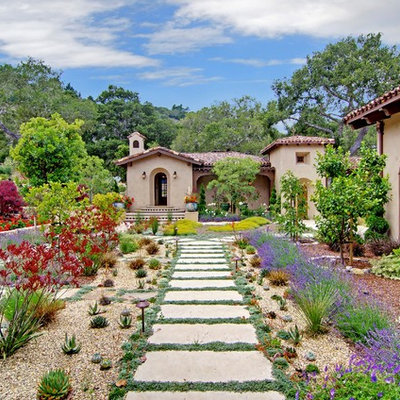 Inspiration for a large mediterranean full sun courtyard stone landscaping in San Francisco.