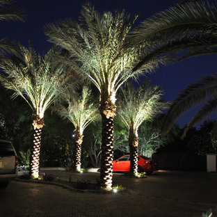 This is an example of a large mediterranean full sun front yard brick driveway in Phoenix.