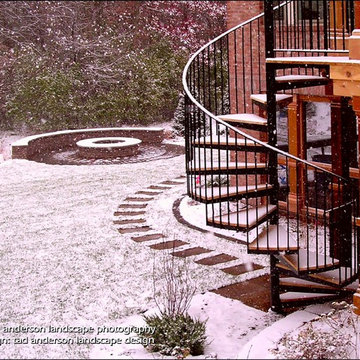 Dramatic Spiral Stair Connects Upper Level Deck to Back Yard. Minnesota Landscap
