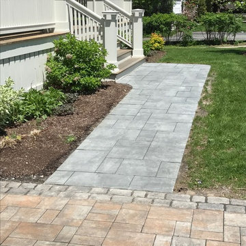 driveway and walkway with granite cobble border