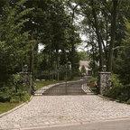 Stone Veneer Driveway Entrance Garden Area With Pillar