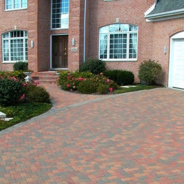 Driveway featuring Unilock Camelot paver with Brussels Block banding