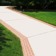 Traditional Landscape by Paving Corporation