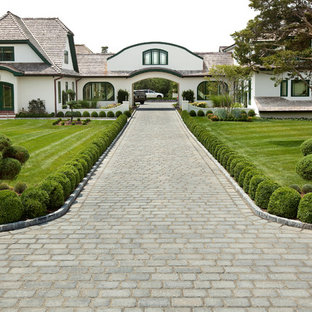 This is an example of a huge traditional full sun front yard concrete paver driveway in Philadelphia.
