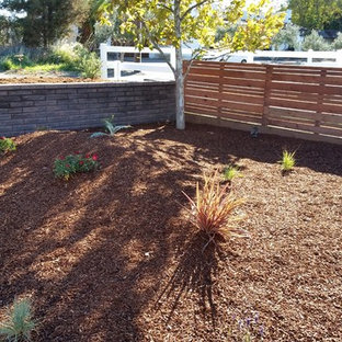 Design ideas for a large traditional full sun front yard mulch formal garden in San Francisco.