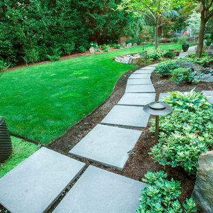 Inspiration for a mid-sized mid-century modern partial sun backyard concrete paver garden path in Portland for summer.