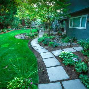 This is an example of a mid-sized mid-century modern full sun backyard concrete paver garden path in Portland for summer.