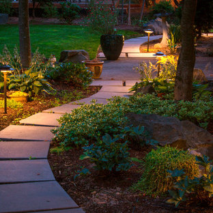 This is an example of a mid-sized midcentury modern full sun backyard concrete paver garden path in Portland for summer.