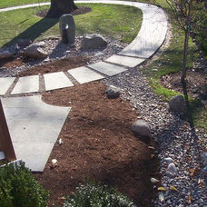 Contemporary Landscape Dry Streambeds Manage Rainwater Beautifully
