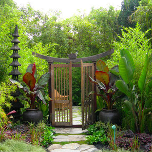 This is an example of a world-inspired back garden in San Francisco with a potted garden and natural stone paving.