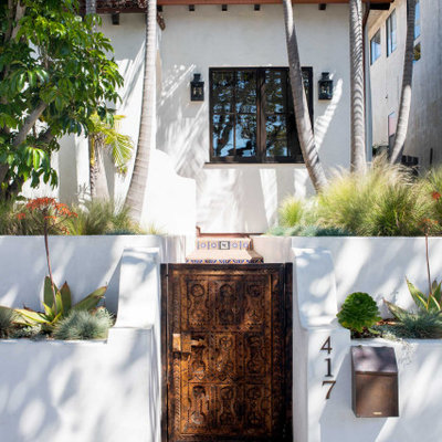 This is an example of a mediterranean partial sun front yard brick garden path in Los Angeles.