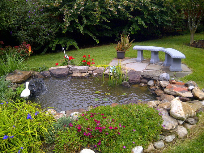Traditional Landscape by Ponds, Patios and Waterfalls Co.