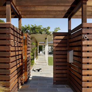 Photo of a mid-sized contemporary full sun front yard stone garden path in San Francisco.