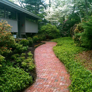 Inspiration for a small contemporary shade front yard brick vegetable garden landscape in Boston for summer.