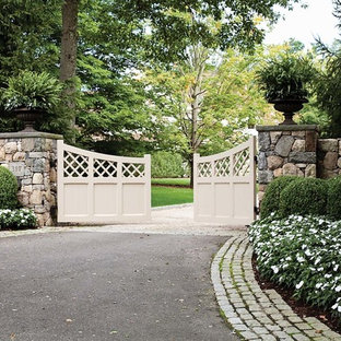 This is an example of a large traditional full sun front yard gravel landscaping in New York for spring.