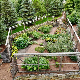 Design ideas for a large rustic full sun side yard mulch and wood fence landscaping in Minneapolis for summer.