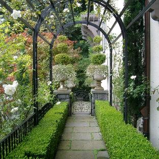 Inspiration for a traditional partial sun garden in Portland with a garden path.