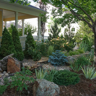Design ideas for a mid-sized traditional partial sun backyard stone landscaping in Denver for spring.