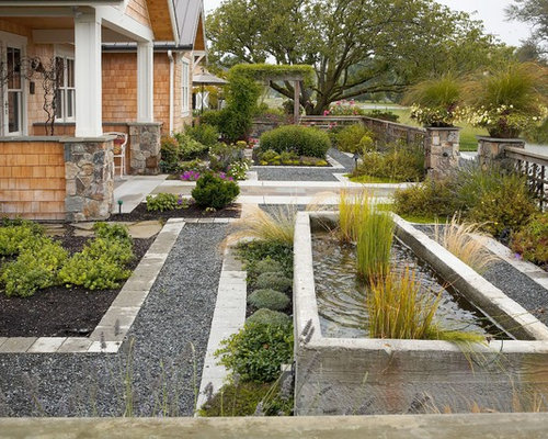 front yard garden. Inspiration for a large traditional full sun front yard concrete paver  water fountain landscape in Seattle Front Yard Garden Houzz