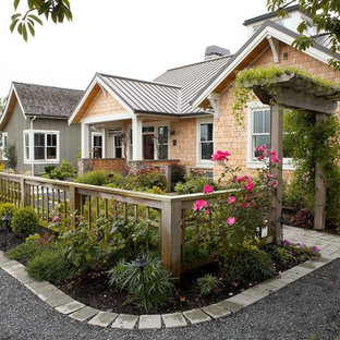 Large country front full sun garden for summer in Seattle with a garden path and gravel.