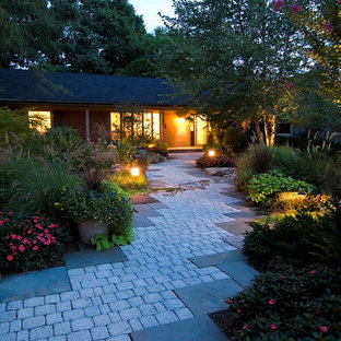 Design ideas for a mid-sized eclectic partial sun front yard concrete paver landscaping in DC Metro for summer.