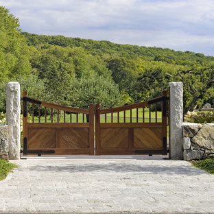 Design ideas for a large rustic front yard stone driveway in New York.
