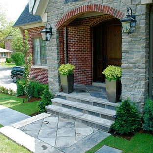 Inspiration for a contemporary front yard stone garden path in Toronto.