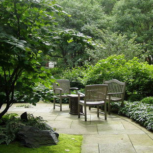 Design ideas for a mid-sized traditional full sun backyard concrete paver landscaping in Chicago.