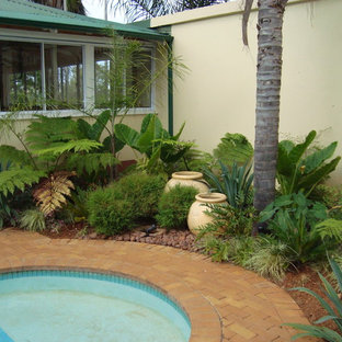 Design ideas for a tropical landscaping in Other.