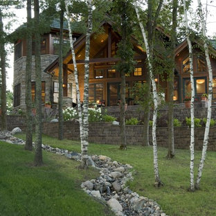 Photo of a rustic retaining wall landscape in Minneapolis.