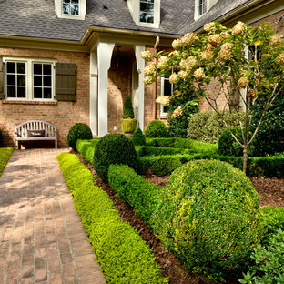 Photo of a large french country partial sun front yard brick garden path in Atlanta.