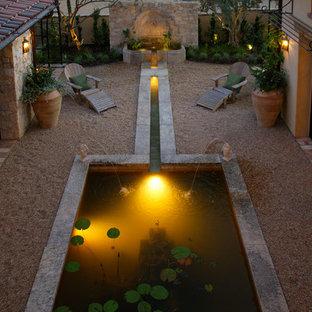 Inspiration for a mediterranean backyard pond in Orange County.