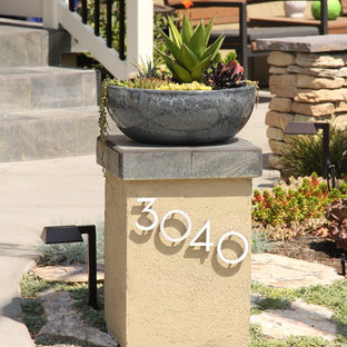This is an example of a contemporary front yard xeriscape in San Diego with concrete pavers.