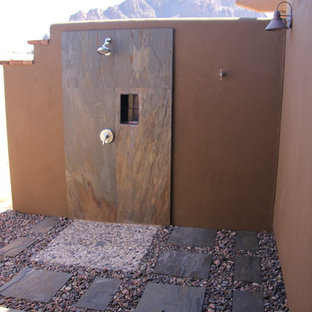 Design ideas for a contemporary drought-tolerant and partial sun side yard stone landscaping in Phoenix for winter.