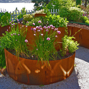 Design ideas for an industrial garden in Seattle with with raised garden bed.