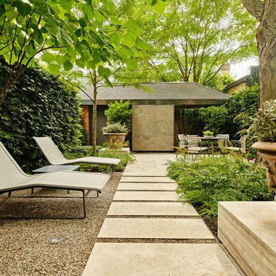 Design ideas for a small contemporary partial sun backyard stone landscaping in Toronto for spring.