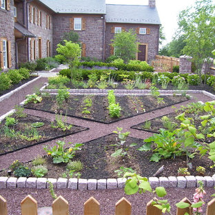 Inspiration for a farmhouse stone landscaping in Philadelphia.