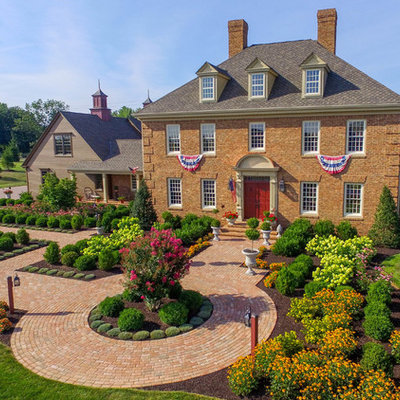 Inspiration for a huge traditional full sun front yard brick landscaping in Philadelphia.