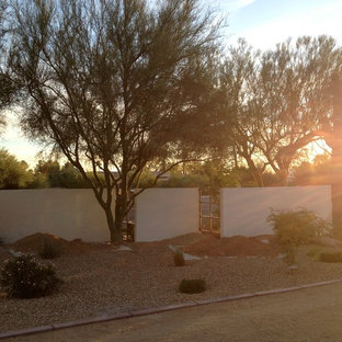 This is an example of a modern drought-tolerant front yard gravel landscaping in Phoenix.