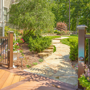 Design ideas for a large traditional side yard stone garden path in Other.