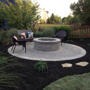 Inspiration for a small contemporary full sun backyard concrete paver landscaping in Kansas City with a fire pit for fall.