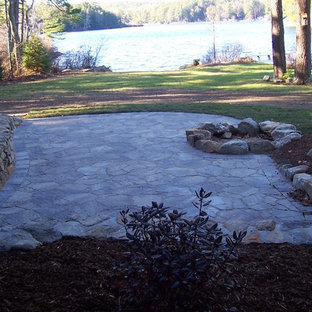 Inspiration for a mid-sized rustic shade backyard concrete paver landscaping in Boston with a fire pit for summer.